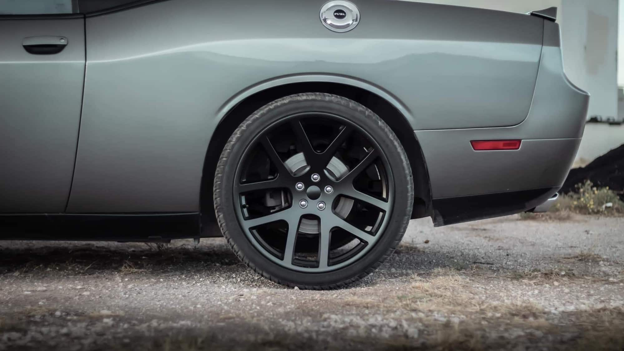 A close up on the Factory Reproductions Fr64 22x10 +18  on this Challenger R/T