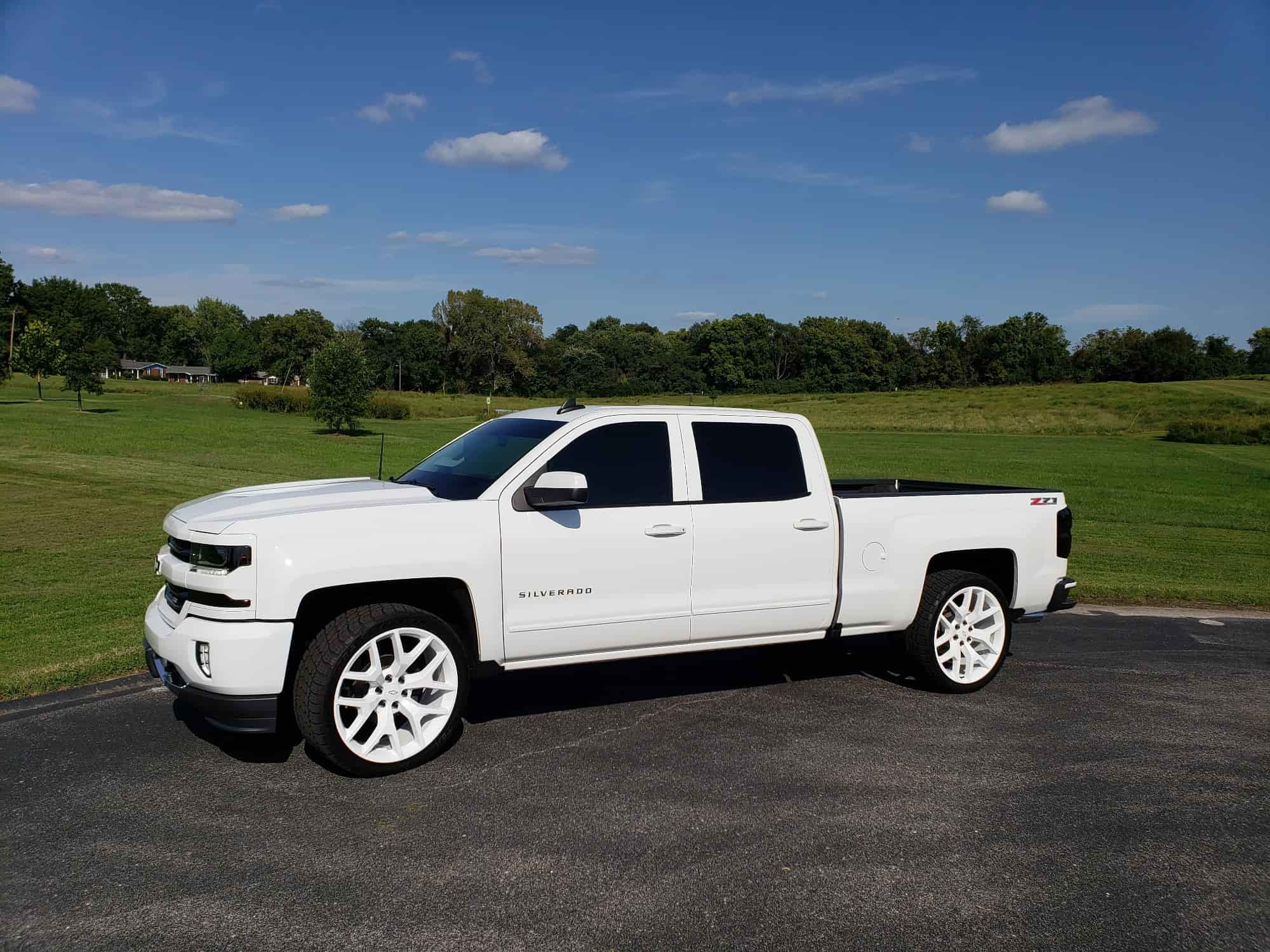 A 2017 Chevrolet Silverado 1500 running the Factory Reproductions Fr44 24x10 +31 wrapped in the Nitto Terra Grappler G2 305/35 and riding on Stock Suspension