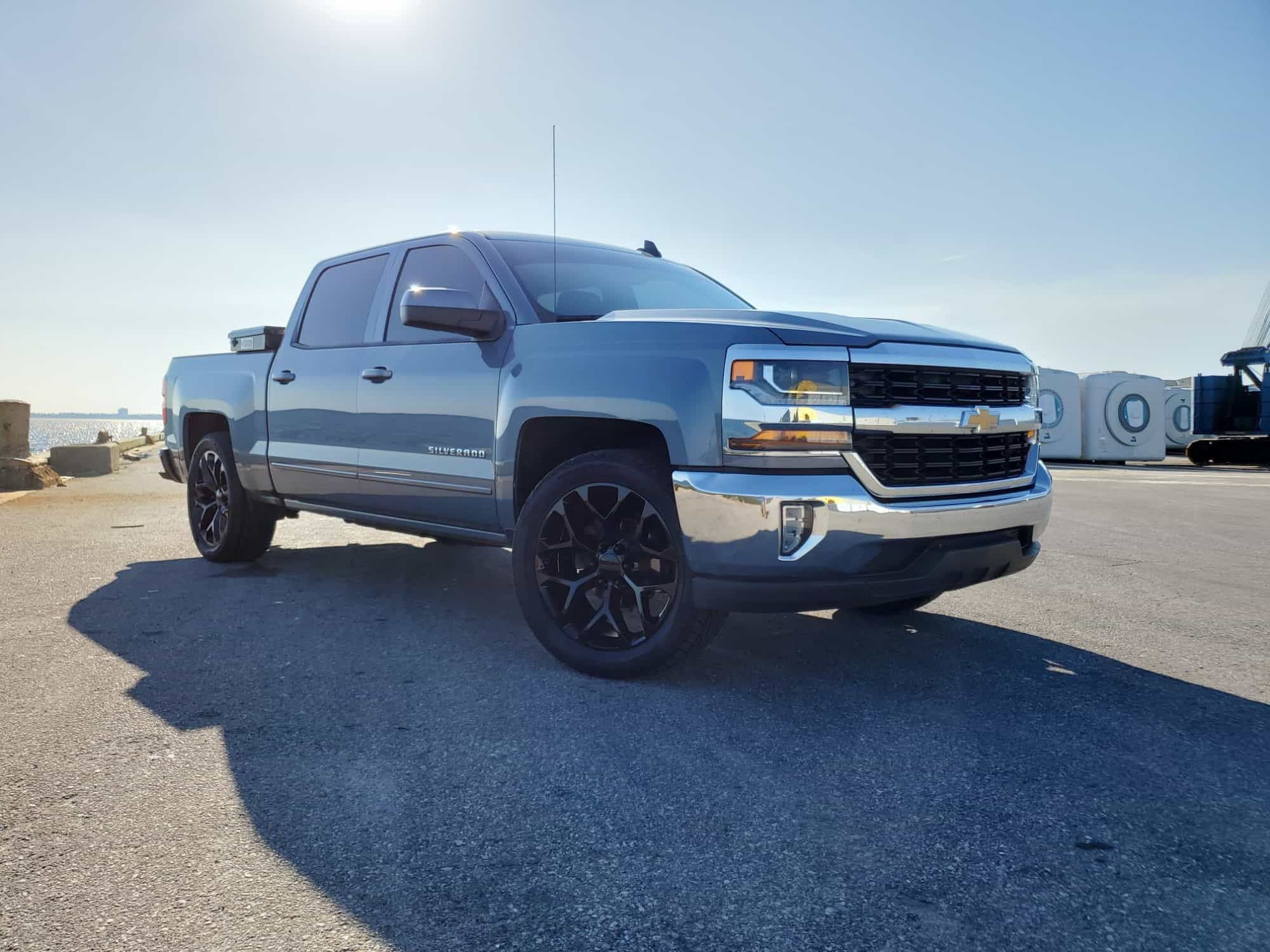 A 2016 Chevrolet Silverado 1500 with the Factory Reproductions Fr59 22x9 +31 wrapped in some Toyo Tires Proxes St Iii 305/45 and riding on Stock Suspension