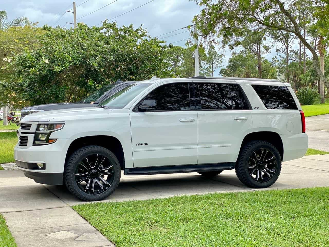 A 2016 Chevrolet Tahoe running the Factory Reproductions Fr72 22x9 +24 wrapped in Atturo Trail Blade Xt 305/45 and riding on a Maxx Leveling Kit
