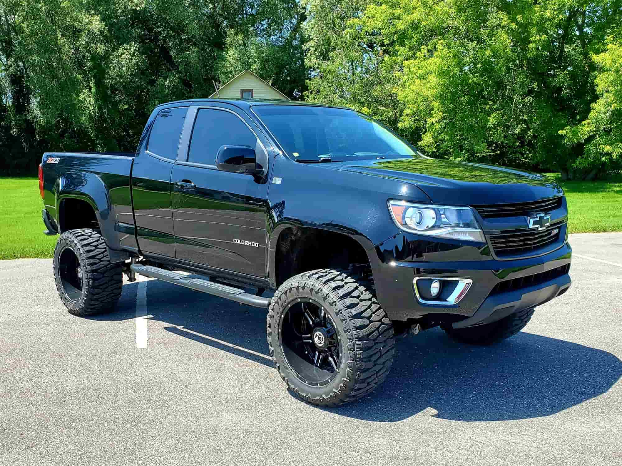 A black and lifted Chevy Colorado running the Anthem Off-Road Equalizer