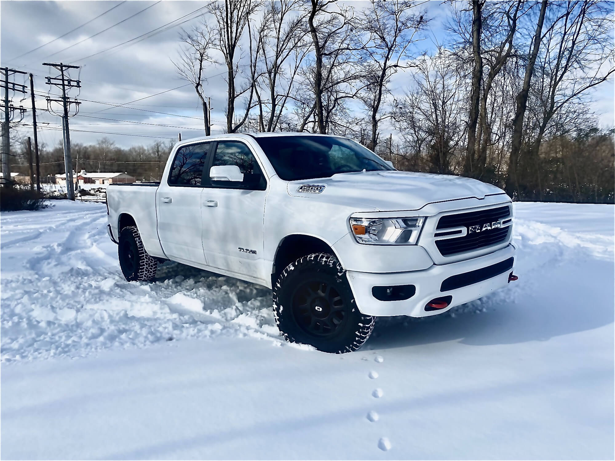 Ram with All Terrain Tires in Snow