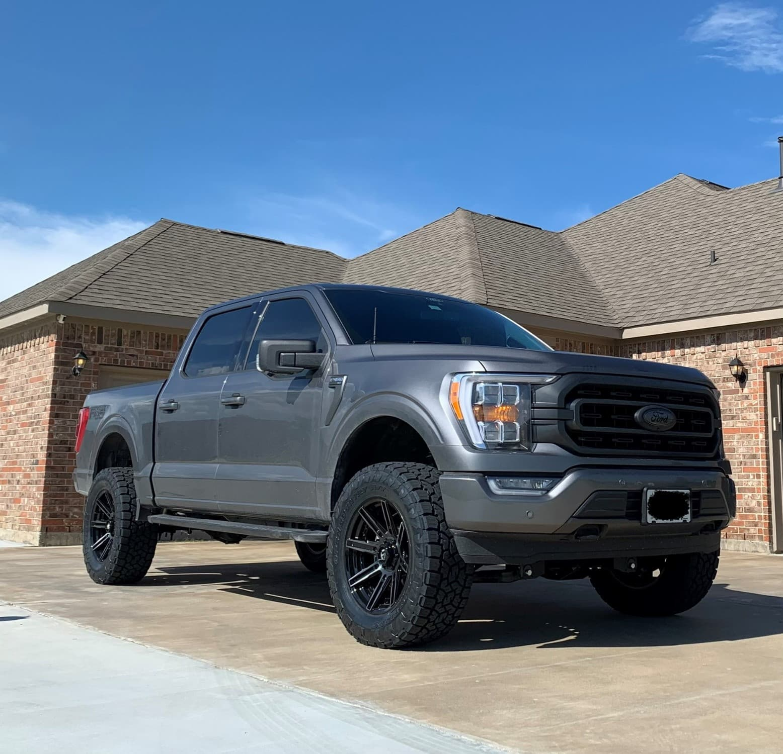 Side shot of a 2021 FORD F-150 with the Fuel Rogue wrapped in some Toyo Tires Open Country A/t Ill 35