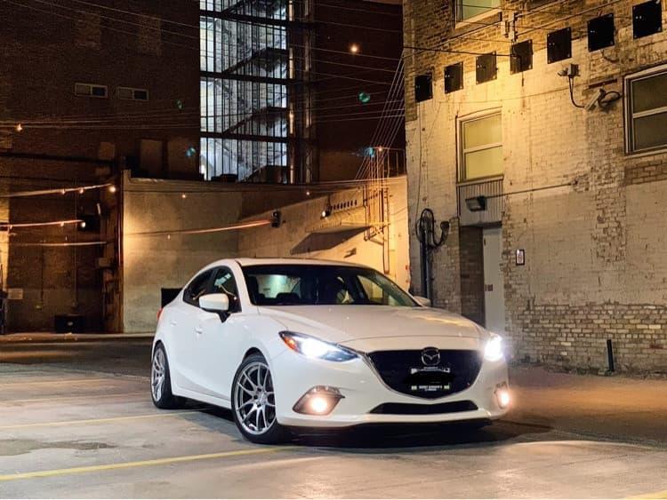 a white 2016 MAZDA 3 GT AVID1 Av32 18x8.5 +35 Toyo Tires Extensa Hp Ii 235/40