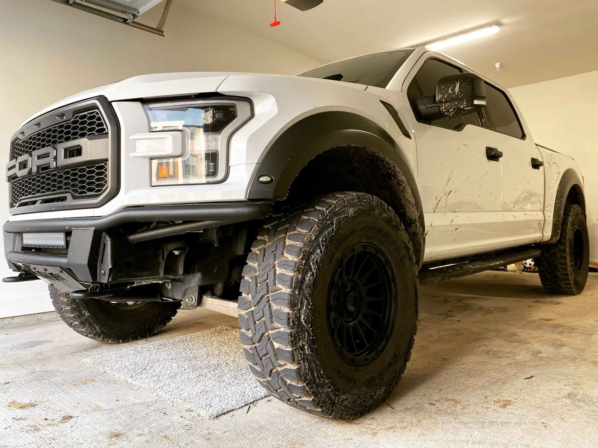 Side shot of a White 2018 FORD F-150 KMC Km542 18x9 0 Toyo Tires Open Country R/t 37