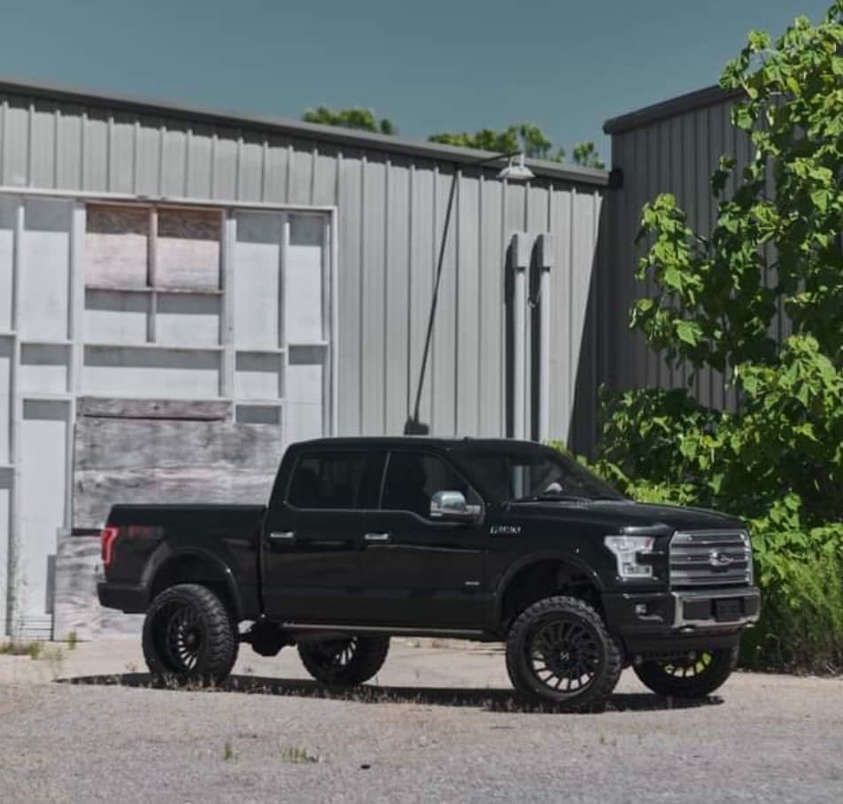 """Side shot of a 2016 FORD F-150 with ARKON OFF-ROAD Caesar wheels, Atturo Trail Blade Mts, and ReadyLIFT Suspension Lift 7"""""""