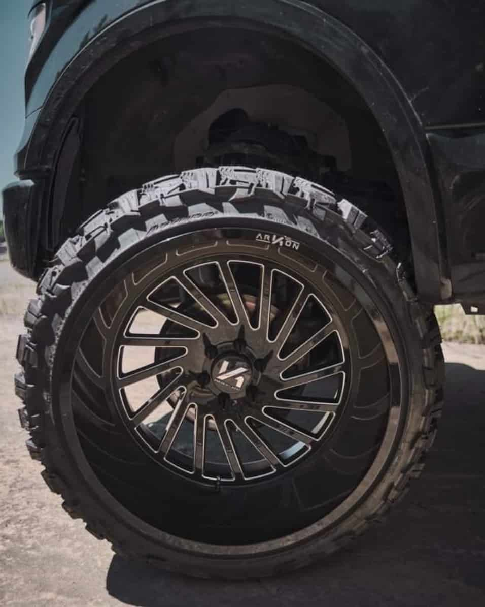 """Wheel shot of a 2016 FORD F-150 with ARKON OFF-ROAD Caesar wheels, Atturo Trail Blade Mts, and ReadyLIFT Suspension Lift 7"""""""
